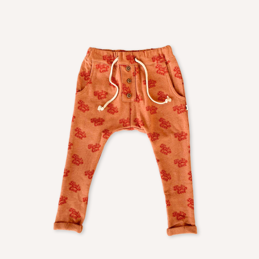 US stockist of My Brother John's Ziggy long john pants. Made in warm orange fabric with cozy fleecy lining, drop crotch, pockets, functional drawstring at waist and decorative buttons down the front.