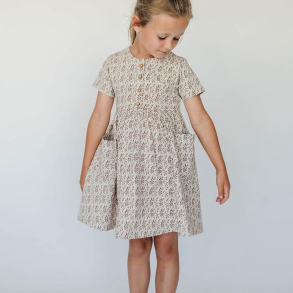 US stockist of Buck & Baa's Rosemary Dress.  Made from organic cotton, with all over rosemary print, two front pockets and coconut buttons down front placket.