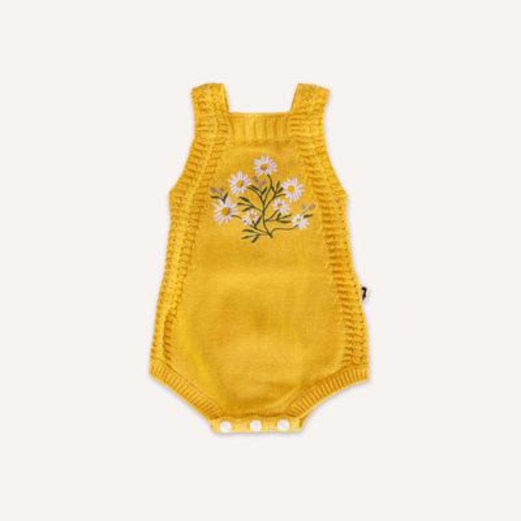 US stockist of Lacey Lane's yellow Daisy romper.  Made from 100% cotton with daisy embroidery on the front and snaps at crotch.