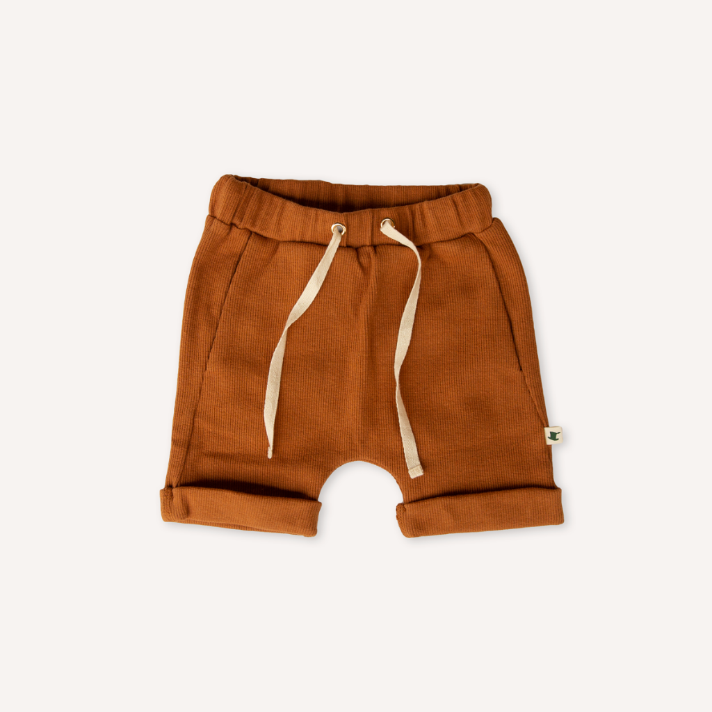 US stockist of My Brother John's Wilbur Dak Shorts in a fine rib rust colored fabric which cream drawstring waist and cuffed hem.