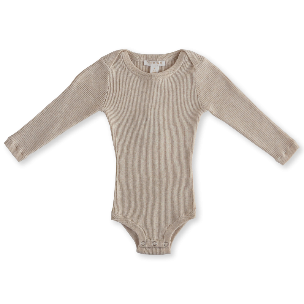 US stockist of Grown Clothing's long sleeve, ultra soft oatmeal bodysuit.  Made from a thin rib, organic cotton fabric with snaps at crotch.