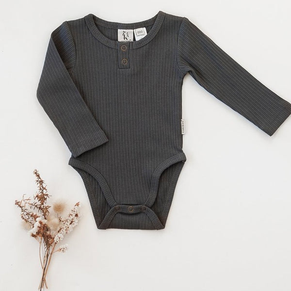 US stockist of Karibou Kids gender neutral, pepper grey Willow long sleeve henley bodysuit in ribbed cotton blend.