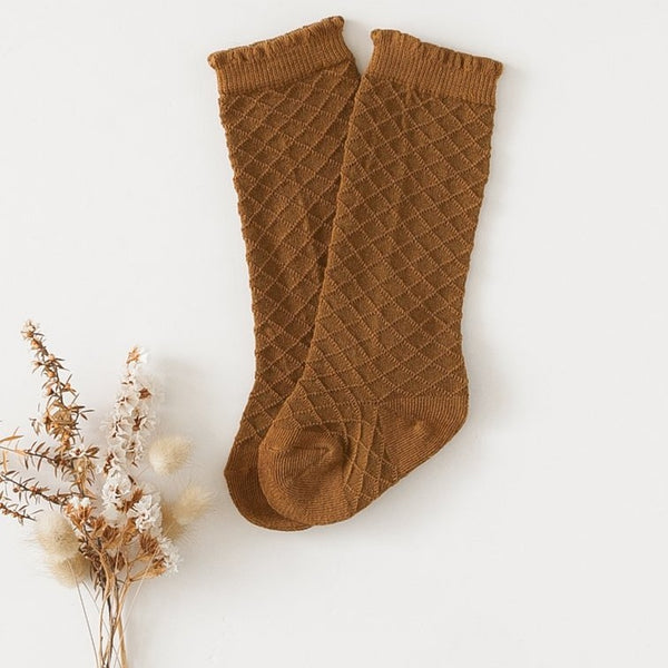US stockist of Karibou Kid's Chestnut cotton socks. Golden chestnut color with mesh texture and frill at top. Cotton blend.