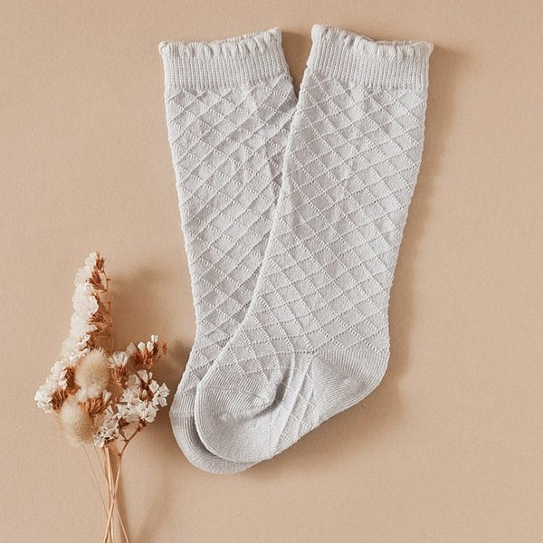 US stockist of Karibou Kid's Cloud cotton socks. Light sky blue color with mesh texture and frill at top. Cotton blend.