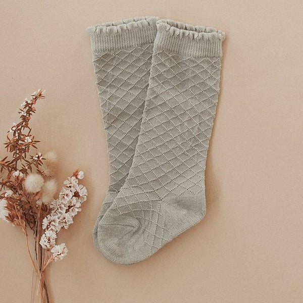 US stockist of Karibou Kid's Conifer cotton socks. Dusty sage green color with mesh texture and frill at top. Cotton blend.