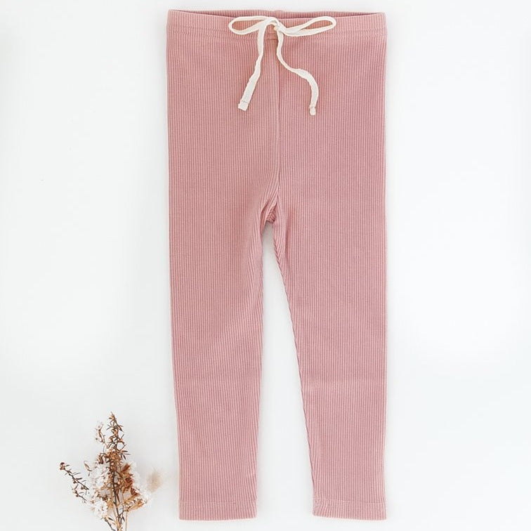 US stockist of Karibou Kids ribbed cotton leggings in blush.  Features non functional contrasing cream drawstring at waist.