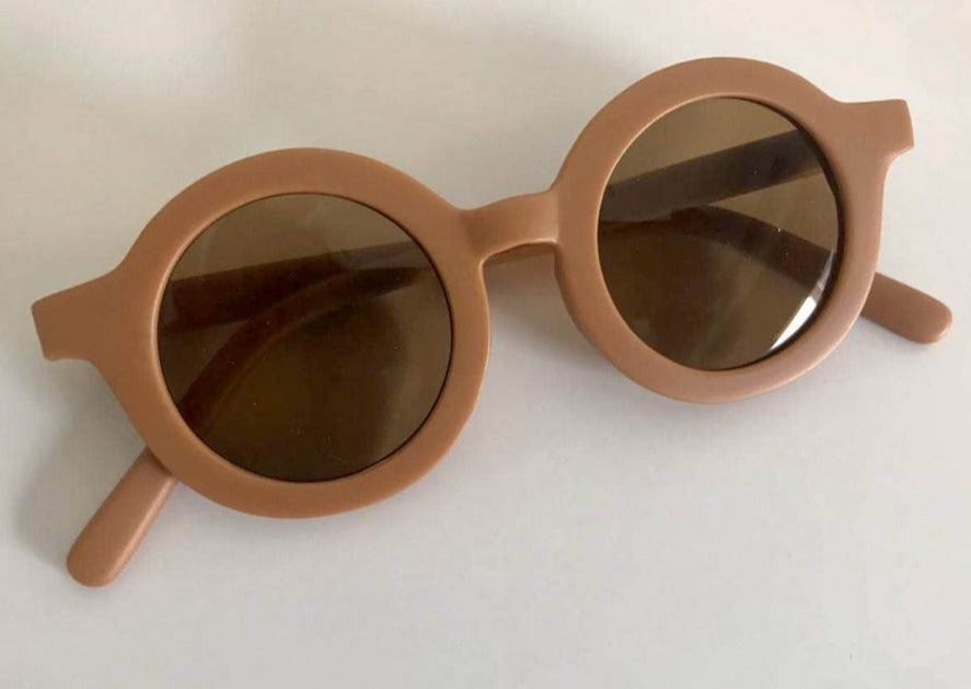 US stockist of Grech & Co's gender neutral sustainable sunglasses.  Made from recycled plastic, with round grey lens with UV 400 protection in a spice color.