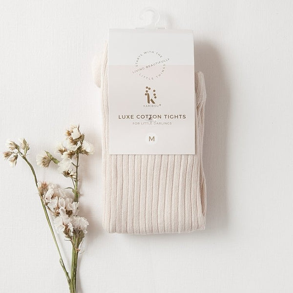US stockist of Karibou Kid's gender neutral ribbed cotton tights in macaroon.