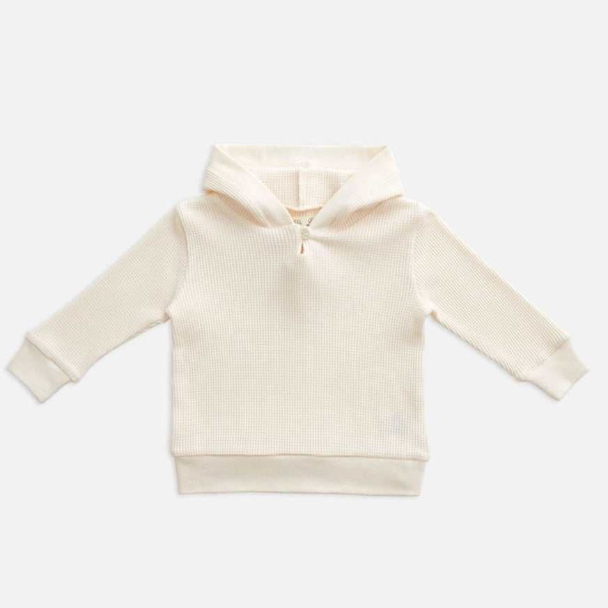 US stockist of Miann & Co's gender neutral jetstream cream baby waffle hooded sweatshirt.  Made from 100% waffle cotton.