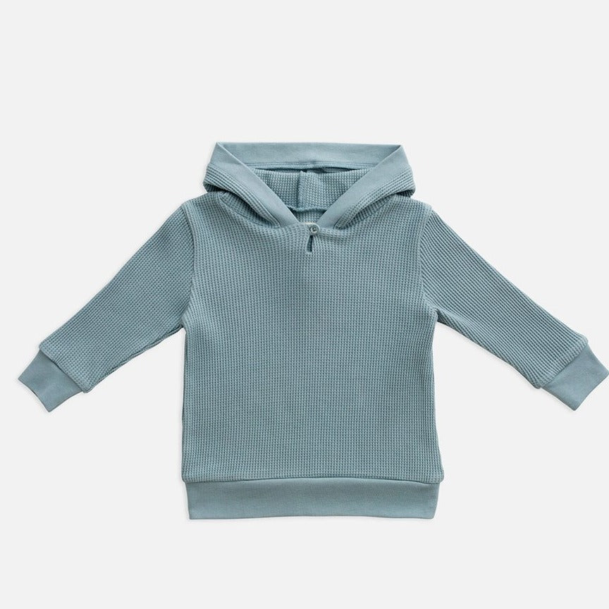 US stockist of Miann & Co's gender neutral slate blue/grey waffle hooded sweatshirt.  Made from 100% waffle cotton.