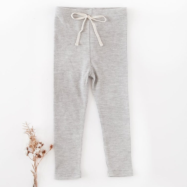US stockist of Karibou Kids gender neutral ribbed cotton leggings in grey marle.  Features non functional contrasing cream drawstring at waist.