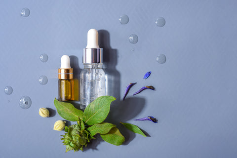 Two bottles of skincare products with herbal accents, bakuchiol vs retinol skincare ingredients