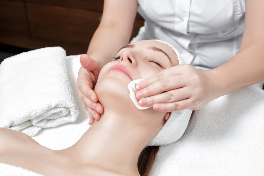 A woman receiving dermaplaning after care, dermaplaning side effects