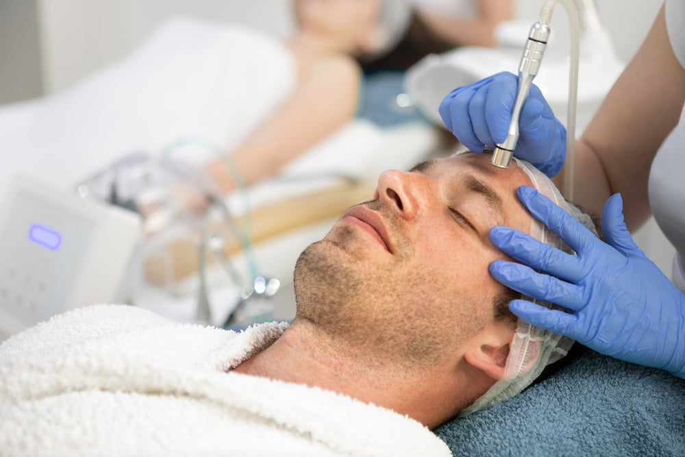 A man receiving microdermabrasion, facials for acne
