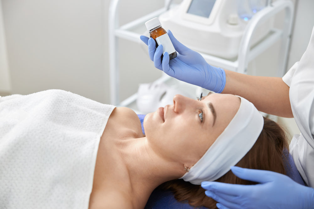 A woman receiving a chemical peel, facials for acne