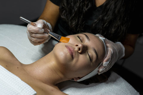Woman getting the spa service Power Peel at the medi-spa Skin Spa New York