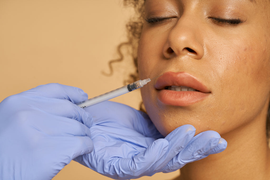 Woman receiving lip injections