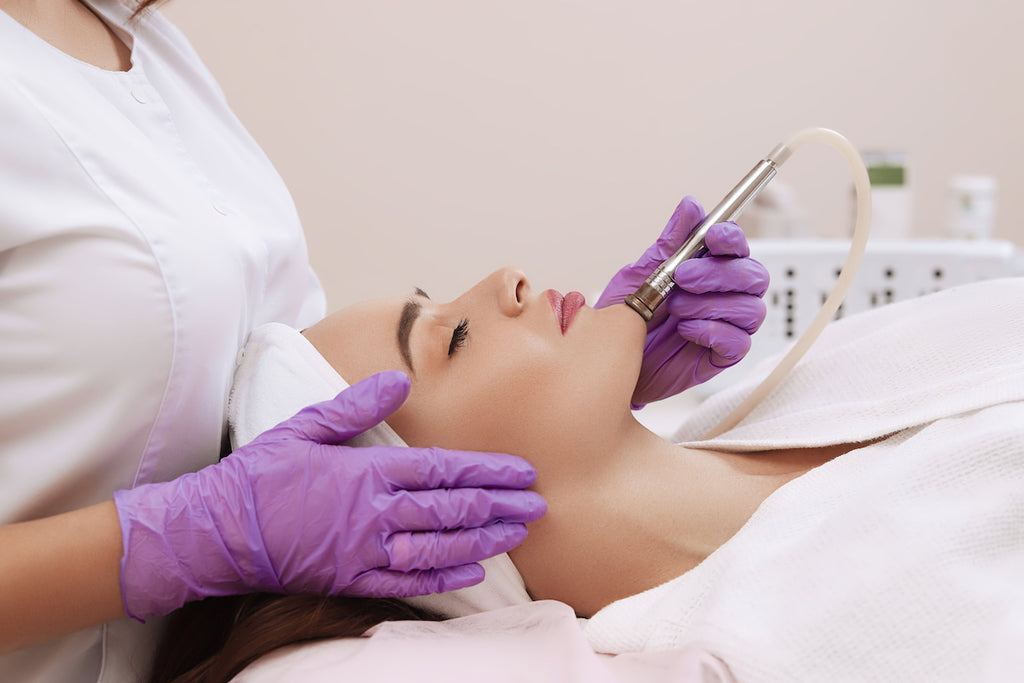 A woman getting microdermabrasion at a medi-spa like Skin Spa New York, microdermabrasion before and after