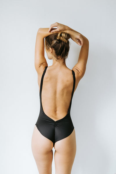low coverage, compression one piece body suits swimsuits made out of recycled fibres, sustainably and locally made in vancouver bc