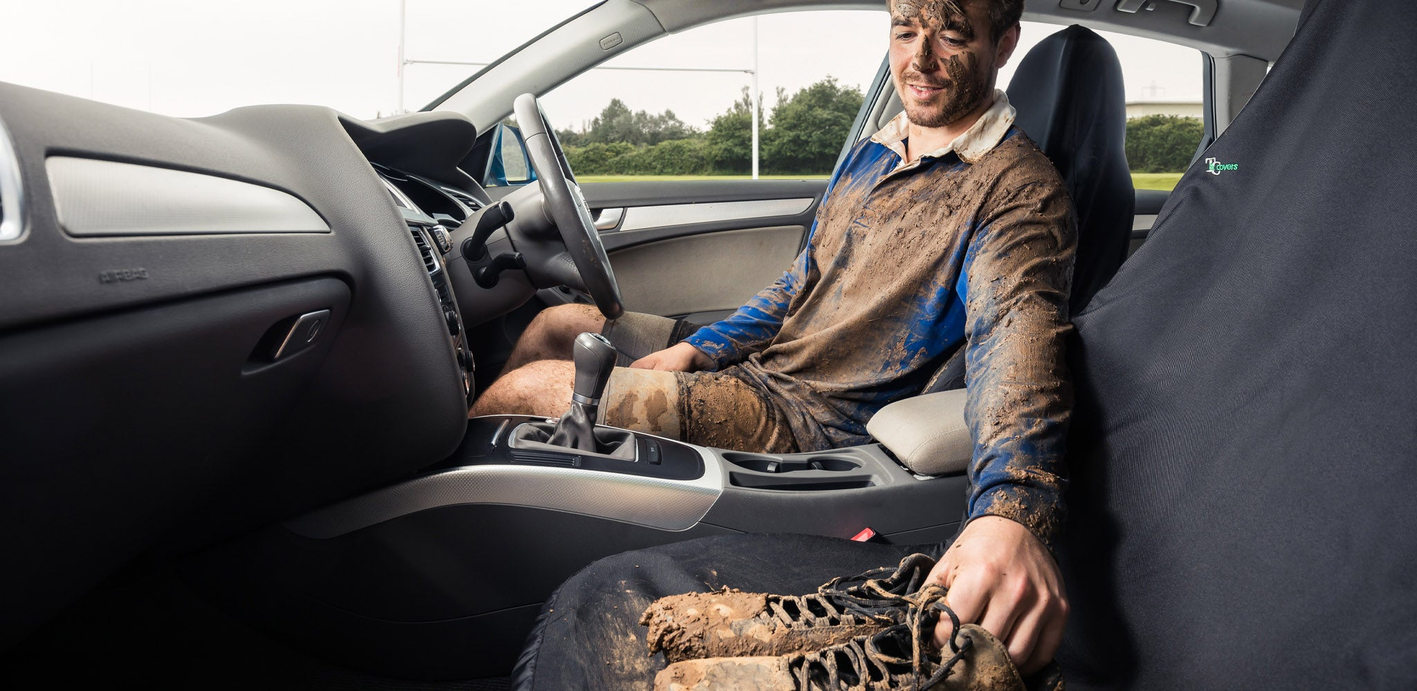 Muddy boots on seat with rugby player