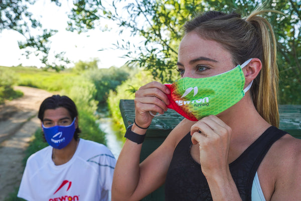 Woman putting on Newton Running face mask