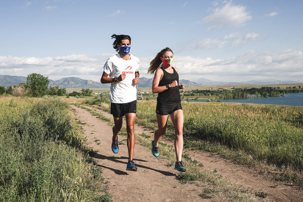 Man and woman running in Newton face masks