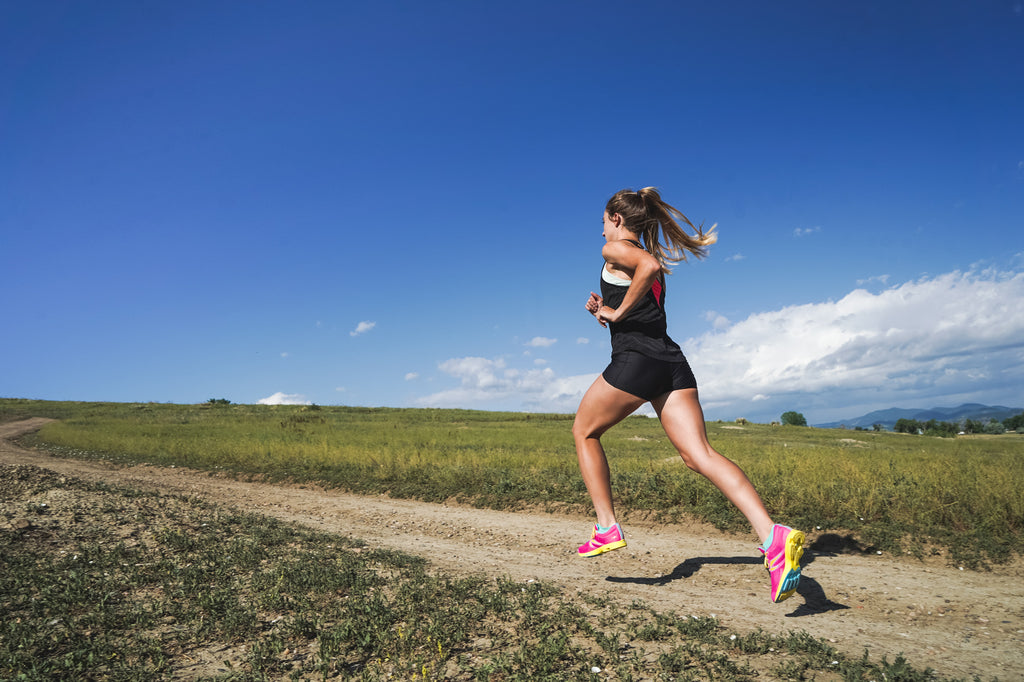 Woman running in the Distance Elite