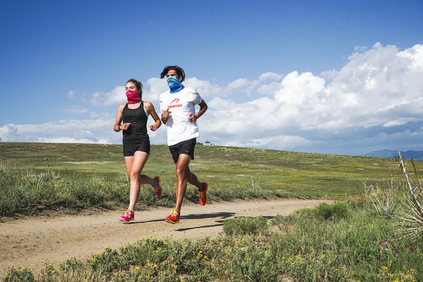 Man and woman running in the Multi-Purpose Gaiter