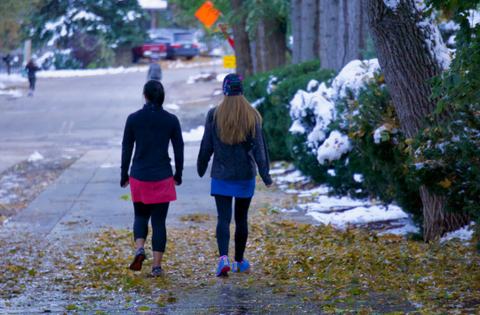 Two women walking on a cold day