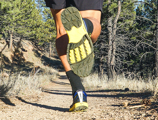 Man running a trail wearing Newton Men's BOCO AT 3