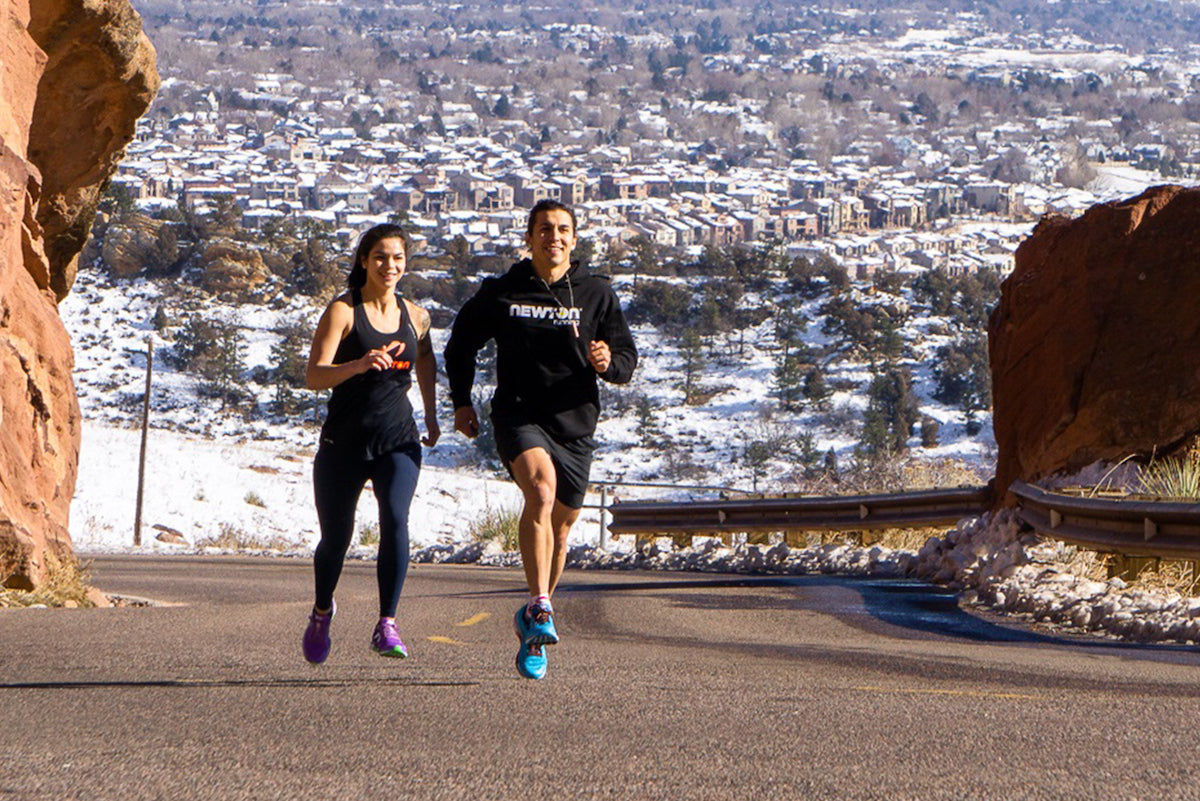 Couple running outside in Newton Motion 8 shoes