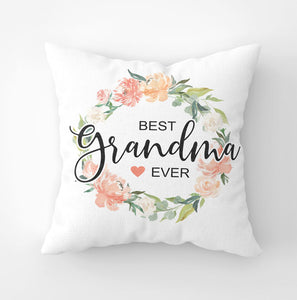 White canvas throw pillow with 'Best Grandma Ever' saying and peach floral wreath