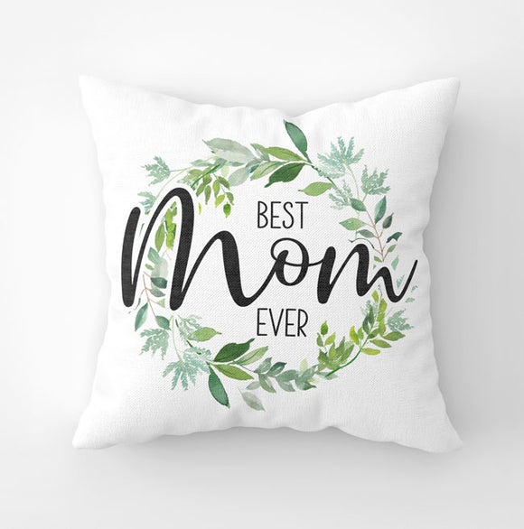 White canvas throw pillow with 'Best Mom Ever' saying and green botanic wreath