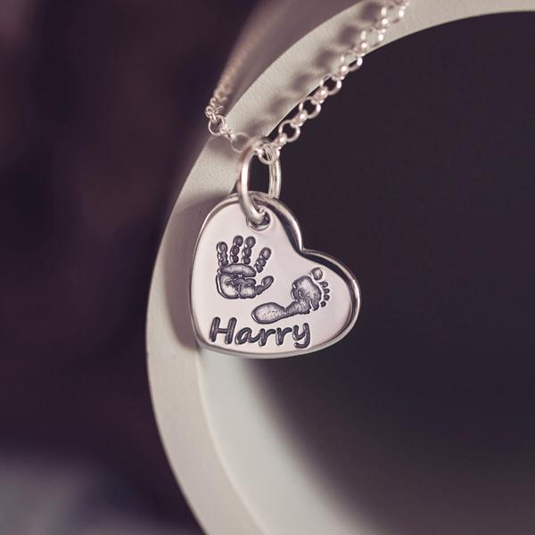 handprint and footprint heart necklace
