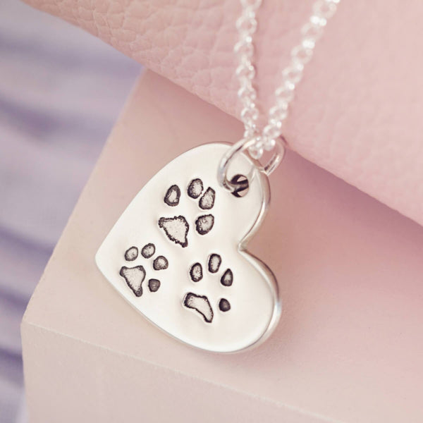 pawprint heart necklace with three dogs paw prints
