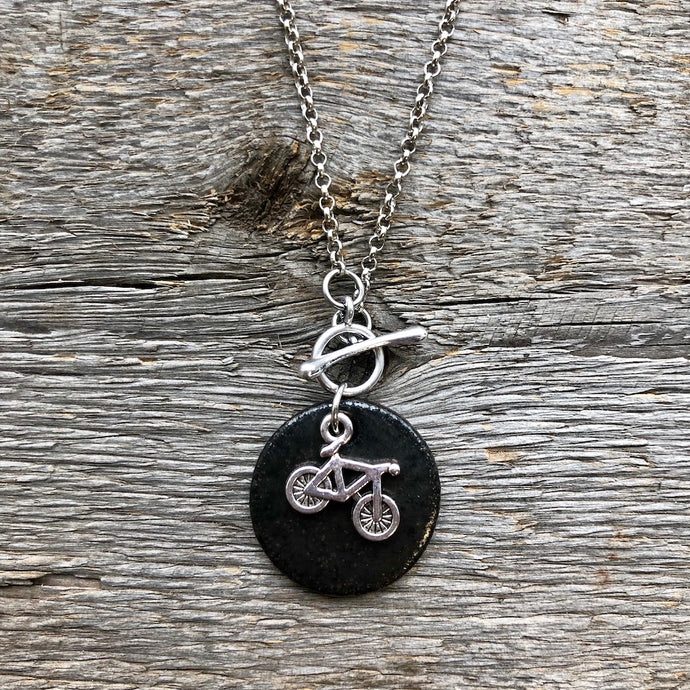 CHARM NECKLACE IN BLACK WITH BICYCLE
