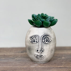 TWO FACED VASE