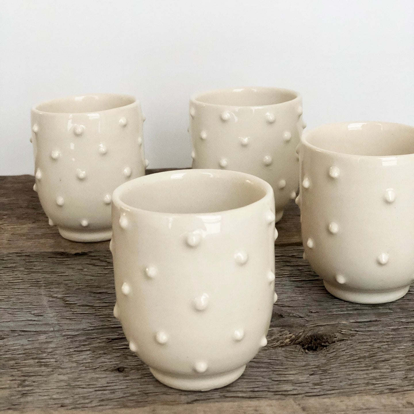 IVORY SHOT CUPS WITH DOTS SET OF 4