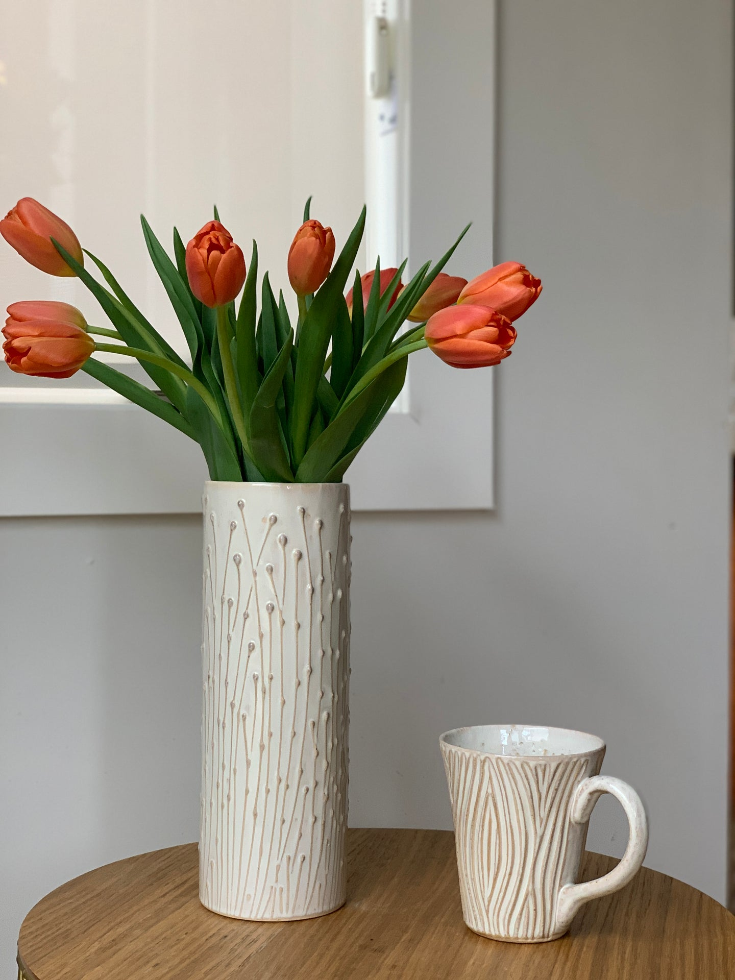 OATMEAL CYLINDER VASE WITH PUSSY WILLOWS