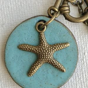 Star Fish Charm Necklace In Blue