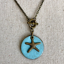 Load image into Gallery viewer, CHARM NECKLACE WITH STAR FISH IN TURQUOISE