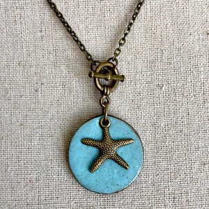 CHARM NECKLACE WITH STAR FISH IN TURQUOISE