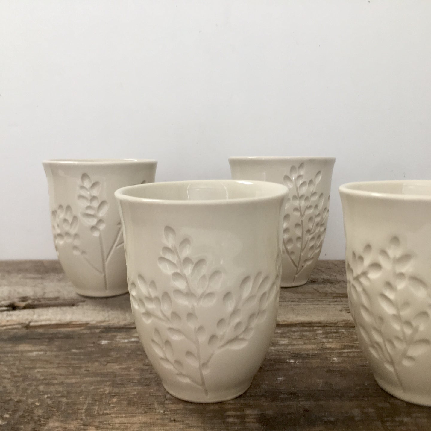 IVORY WINE CUPS WITH CARVED BRANCHES