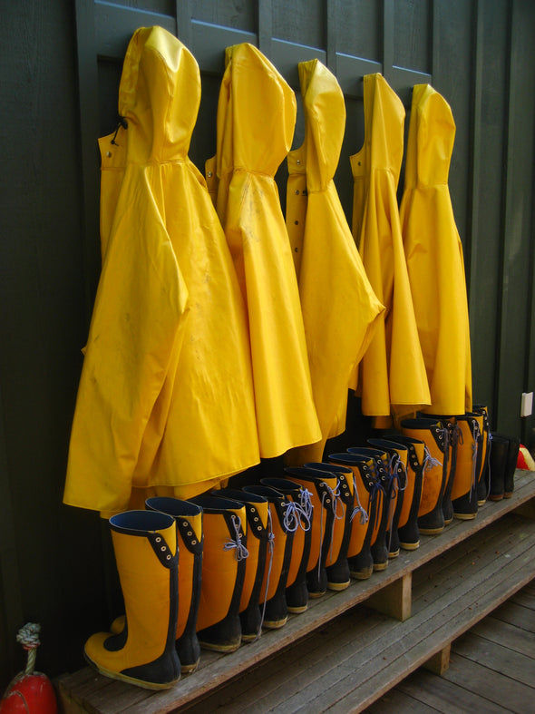 Yellow raincoats and boots hanging and ready when needed