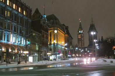 Elgin Street in Ottawa, Ontario lite up at night with a view of Parliament in the background