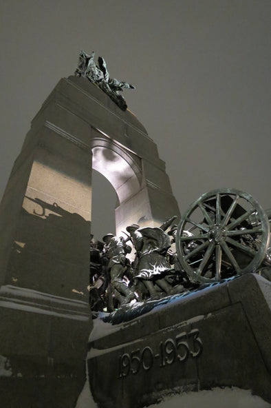 light shining on canada's national war memorial
