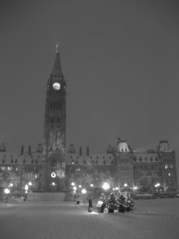 Parliament hill in ottawa during the christmas festival of lights, photographed in black and white