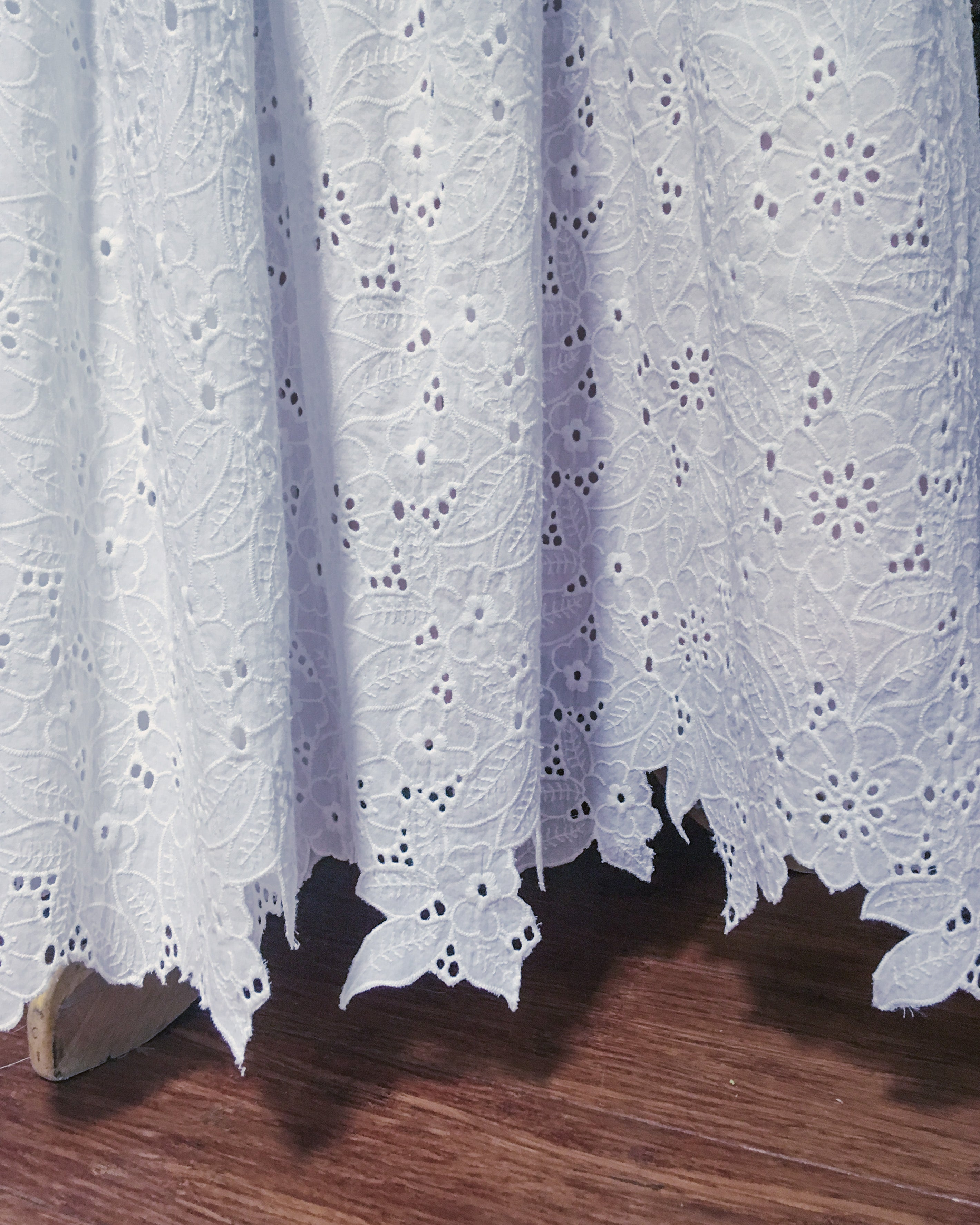 Broderie anglaise fabric with trimmed hem