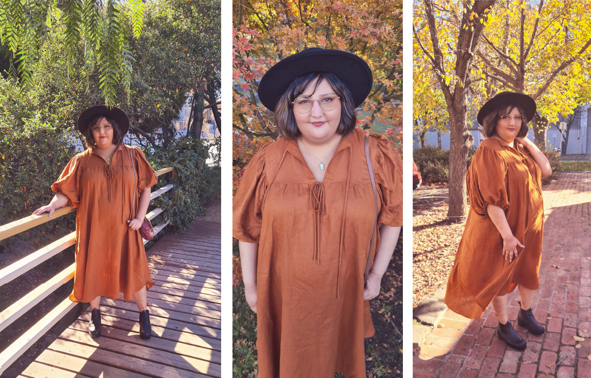 Three images of Vee, a dark haired women wearing her Vali dress in caramel rust linen.  She is wearing a black hat, black boots and mid length linen dress