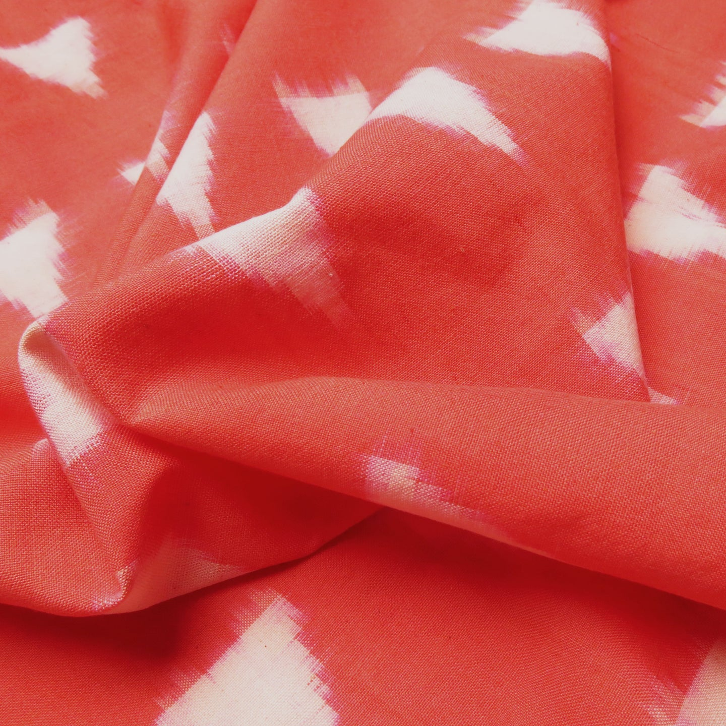 Cotton Ikat - Coral with ivory triangles 0.5m